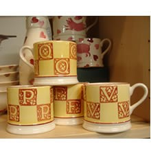 "Yellow  and  Brown Letter Baby Mug ""V"" - Retired"